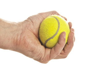 Hand holding tennis ball isolated on white