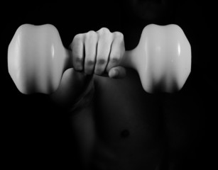 Fist hand with dumbbell
