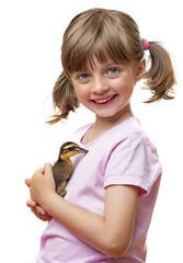 little girl holding one duckling