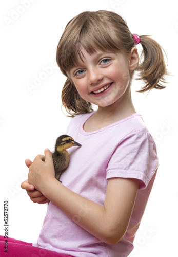 little girl holding a duckling