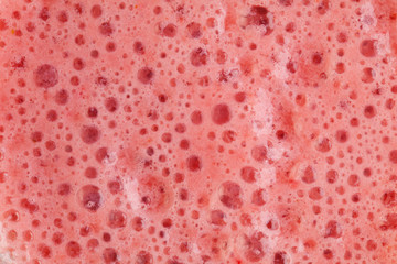 Strawberry milkshake texture. Background. Macro.