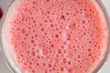 Strawberry milkshake texture. Background. Macro.