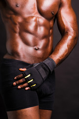 Cropped image of a young muscular man