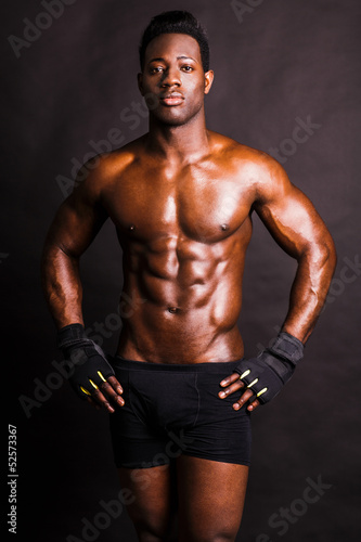 Image of muscle man posing in studio
