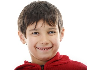 Portrait of happy joyful beautiful little boy isolated on white