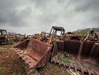 rusty tractor buckets