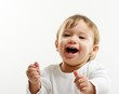 Bright closeup portrait of adorable happy baby