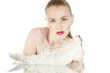 Beautiful  girl with a white  feather. Spy beauty skin treatment