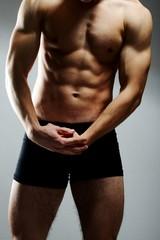 Young sexy muscular man posing