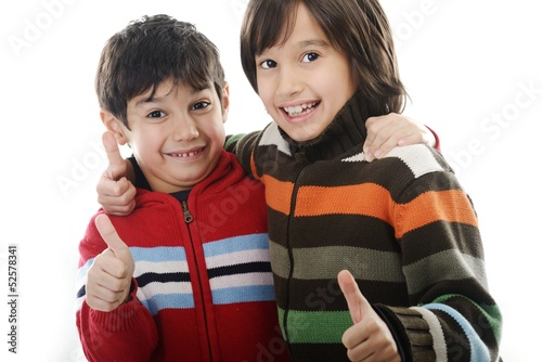 Portrait of happy joyful beautiful little boys isolated on white