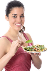 Model Released. Young Woman Eating Chicken and Couscous Salad