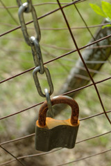 closed padlock on the fence