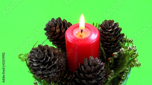 ornamente candle in green background