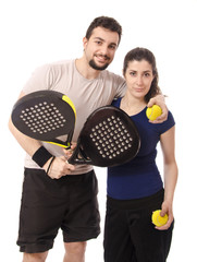 Mixed paddle tennis. Isolated couple.