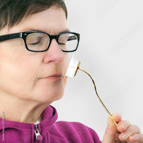 Woman smelling cheese