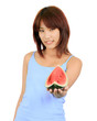 young asian woman with a piece of red watermelon
