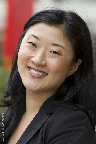 Female Asian business woman smiling
