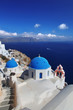 Santorini with churches and sea view in Greece