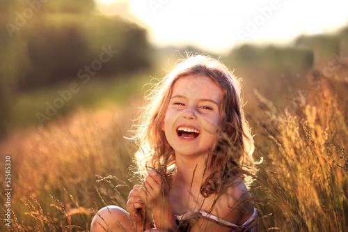 Happy young girl on the meadow