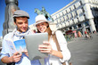 Couple checking on tourist information in Madrid
