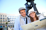 Couple visiting Madrid and checking on city plan