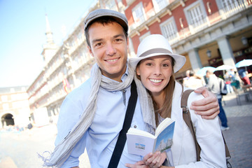 Couple standing in la Plaza Mayor de Madrid