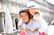 Cheerful couple holding visitor pass of Madrid capital