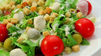 Salad with mozarella cheese - vegetables salad and dressing