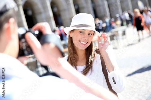 Man taking picture of girlfriend in Madrid