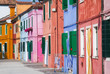 Sunny street with colourful buildings in Burano, Italy.