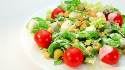 Salad with mozarella cheese and dressing