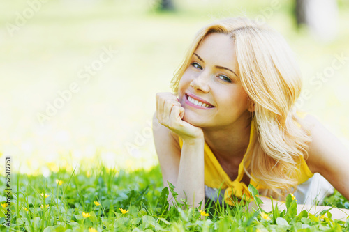 canvas print picture Woman lying on grass