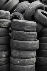 Old used stacked tires. Vertical background texture