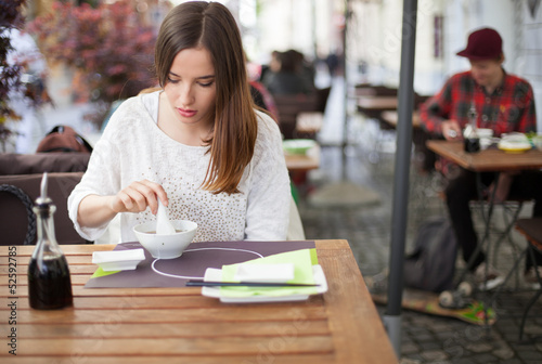 Young woman eating soup in an Asian restaurant