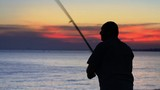Angler fisherman trolling rod and reel fighting saltwater fish poster