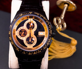 Mens wristwatch and key