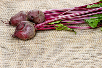 Beetroot on hessian on rustic wooden table