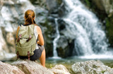 Female hiker looking at waterfall