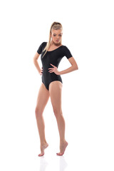 Young slim woman posing in black leotard