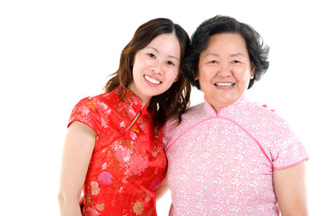 asian mother and daughter in traditional costume, cheongsam