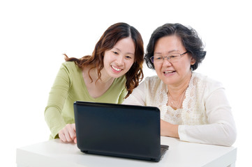 Asian senior woman learns to use computer