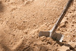 Shovel on the sand closeup - 52596353