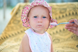 Portrait of cute little baby girl on the beach