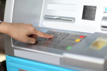 Finger pressing enter after code number insertion on ATM keyboar