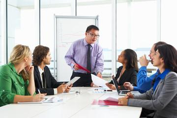 Businessman Conducting Meeting In Boardroom