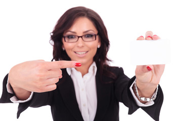 business woman pointing at card