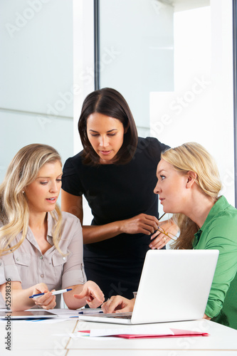 Group Of Women Meeting In Office