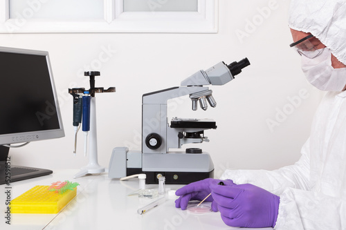 Lab technician taking a sample