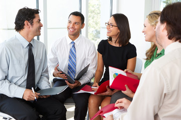 Businesspeople Having Informal Office Meeting