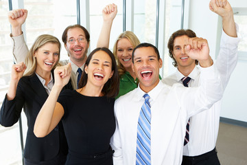 Portrait Of Business Team In Office Celebrating